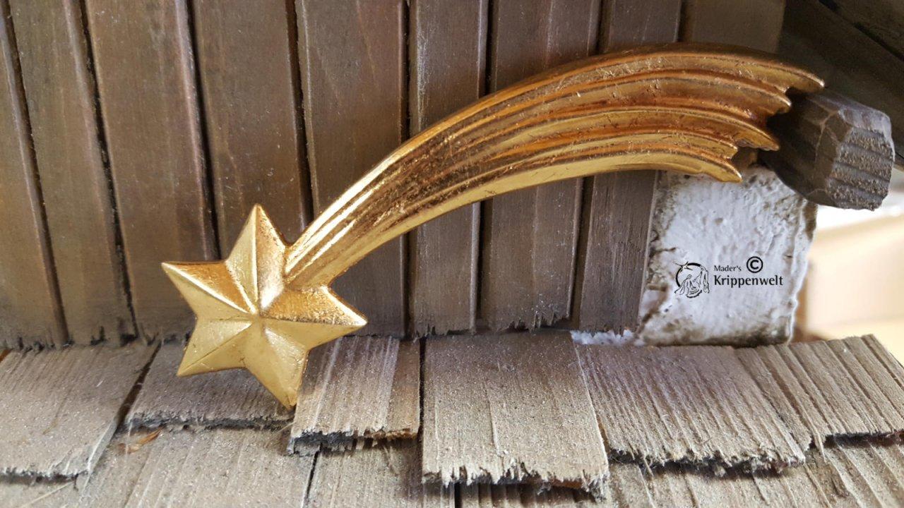 geschnitzter Kometstern aus Holz in Goldfarben