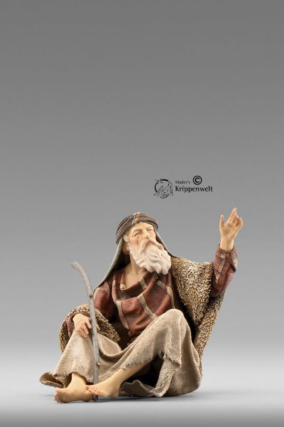 Hirte sitzend mit Stock als Krippenfigur von der Immanuel Krippe