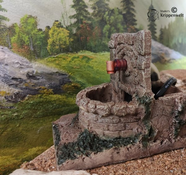 elektrischer Brunnen als Krippendekoration