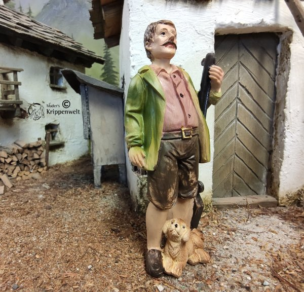 Krippenfigur aus Kunstharz - ein Jäger mit Stock und Hund