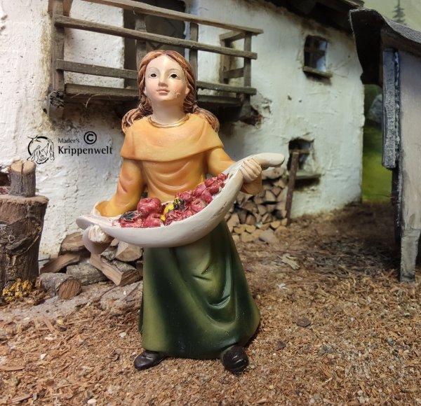 Krippenfigur aus Kunstharz - ein Mädchen mit Obstschale